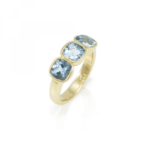 Three Stone Aquamarine ring in yellow gold by Scarab Jewellery Studio
