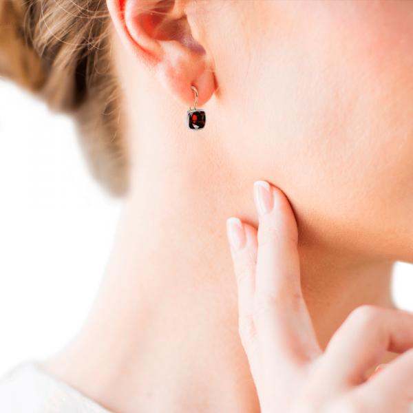 Silver garnet Earrings with cushion cut garnet on model by Scarab Jewellery Studio