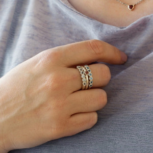 Silver Seven Stone Ring stacked with Silver Flute Ring by Scarab Jewellery Studio